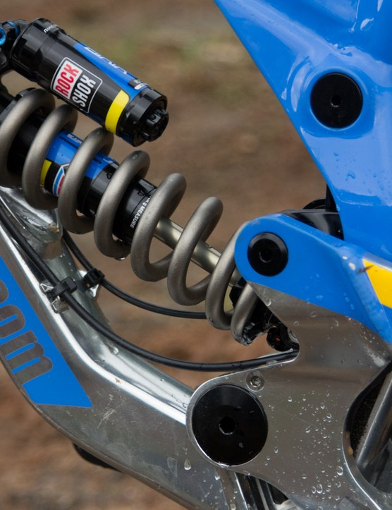 A RockShox Vivid R2C rear shock is driven by Nukeproof's 'three-stage Fallout Linkage' system