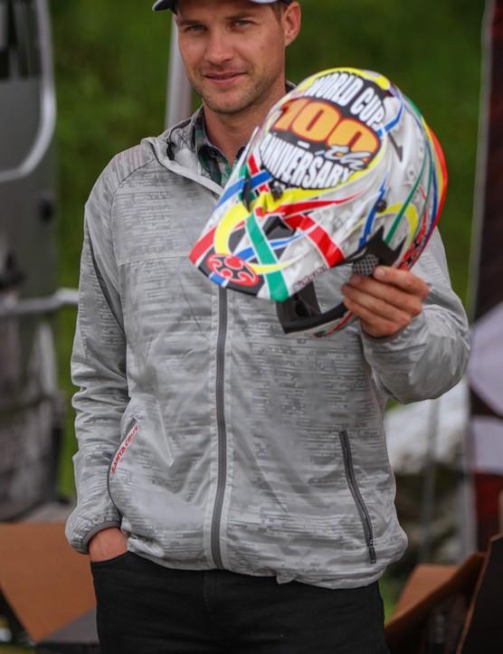 Greg Minnaar shows off a limited edition helmet to celebrate his 100th UCI world cup race