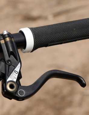 The custom-for-Specialized Magura MTS hydraulic disc brakes pair short-fiber molded carbon fiber master cylinders with one-piece forged aluminum calipers