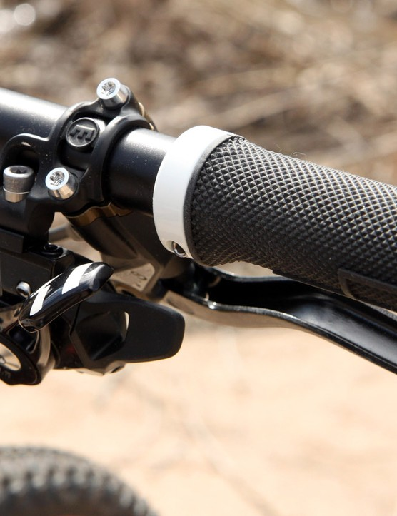The single SRAM X01 shifter is bolted to an integrated clamp for a cleaner-looking cockpit