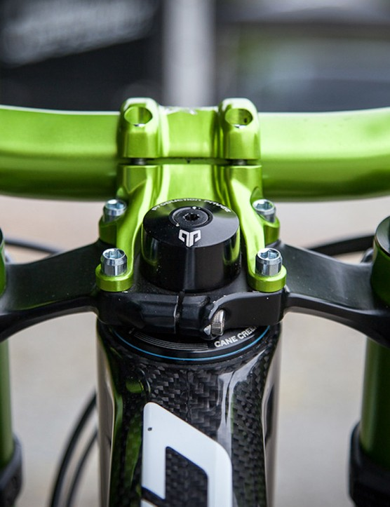 Spank bars and stem complement the green DVO Emerald fork dials and outer legs