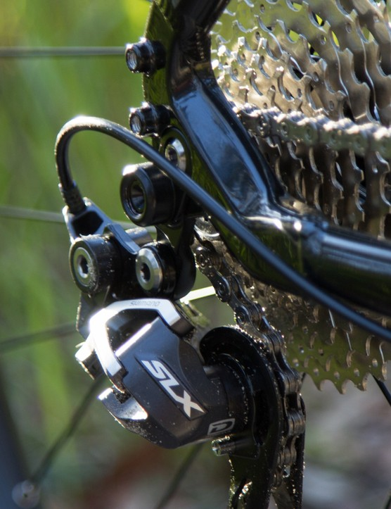 10-speed at the back controlled by a Shimano SLX derailleur. The shifting remained perfect for all our testing