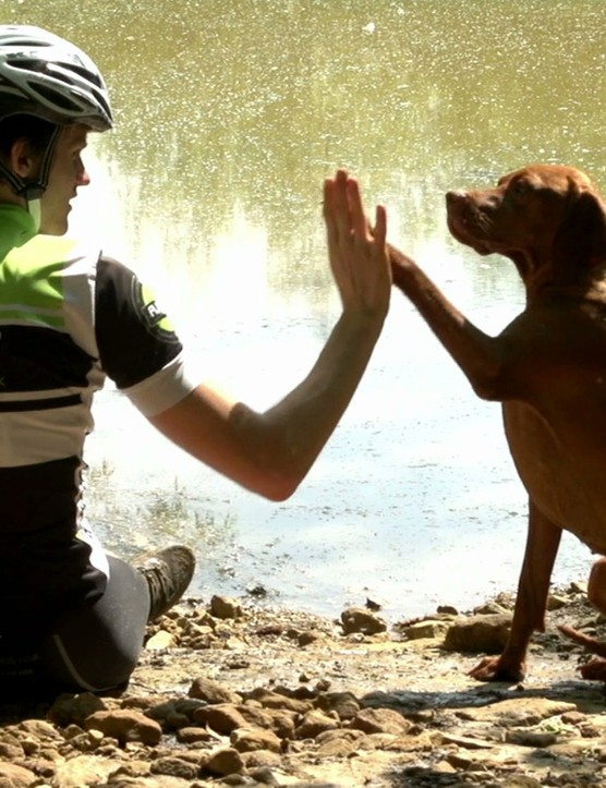 After a speedy singletrack session, Ruby celebrates with a high five