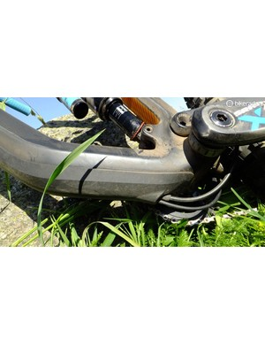 The plastic downtube protector can be removed to reveal the internal cable routing, for easier access