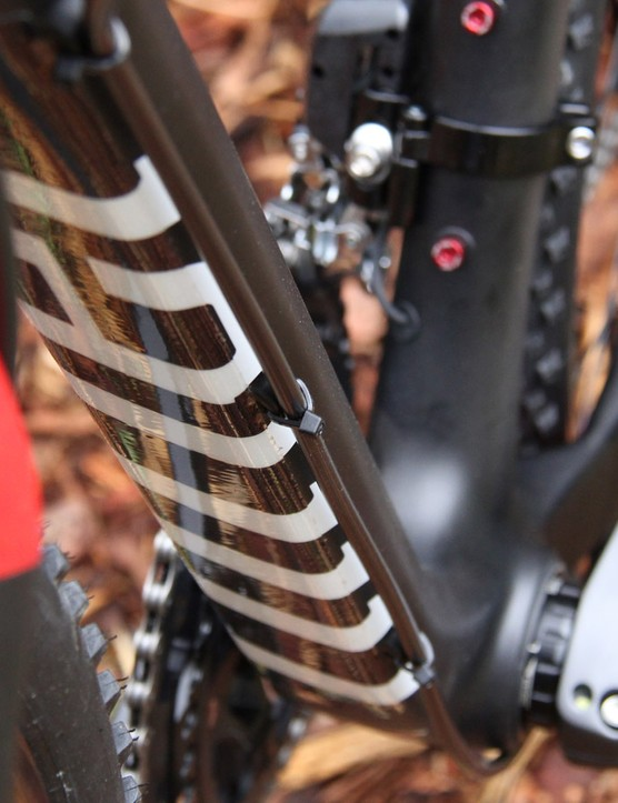 While the shift cables are internally-routed, the rear brake line follows the side of the downtube. It's positioned so that it's out of the way when grabbing the downtube