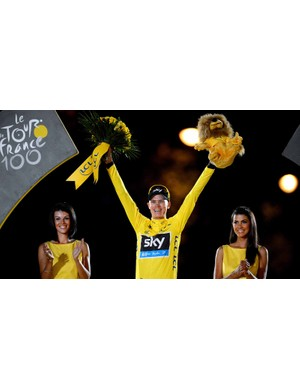 Chris Froome accepts his yellow jersey on the Champs Elysees in Paris last year. Can he make it two in a row?