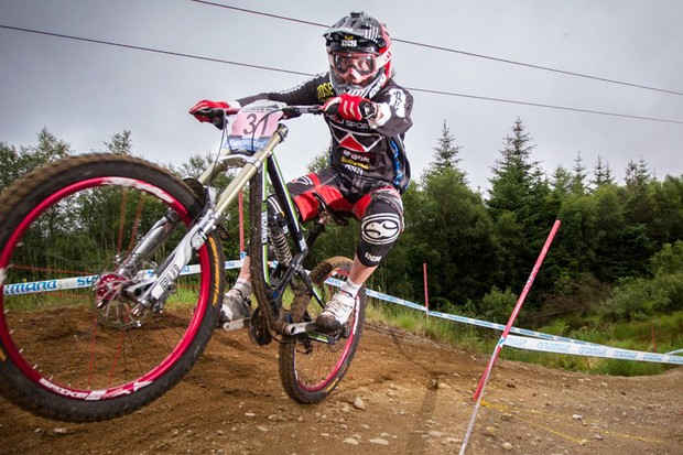Downhill racing viewed in slow motion highlights the riders' grace