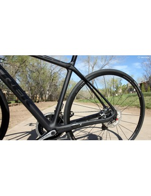 The seatstays are pushed further rearward to make room for the disc brake caliper