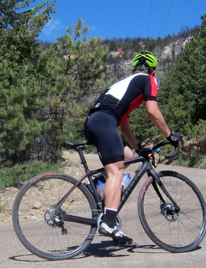 While the disc brakes on the Trek Domane Disc 6.9 only further enhance the standard Domane's already confident descending manners, the stiff chassis and low weight make it an excellent companion when climbing, too