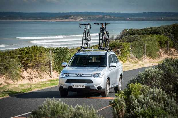 Bike-ready Mitsubishi Outlanders equipped with Thule ProRide bike carriers are now on offer from Europcar Australia