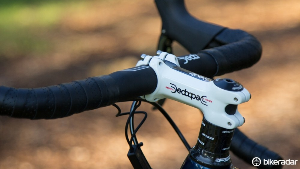 A short Deda stem and a stack of spacers give a more upright position; a slammed, race-ready position awaits with a longer stem