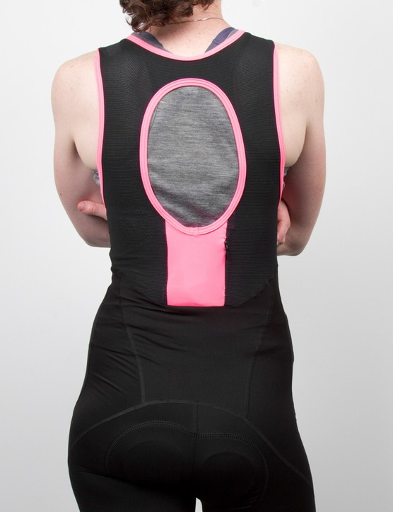 The back bib panel features a large vent