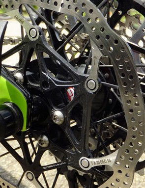 Cannondale sticks with quick-releases for speedy wheel removal. Anton uses four rotor bolts to shave extra grams from the weight of the bike
