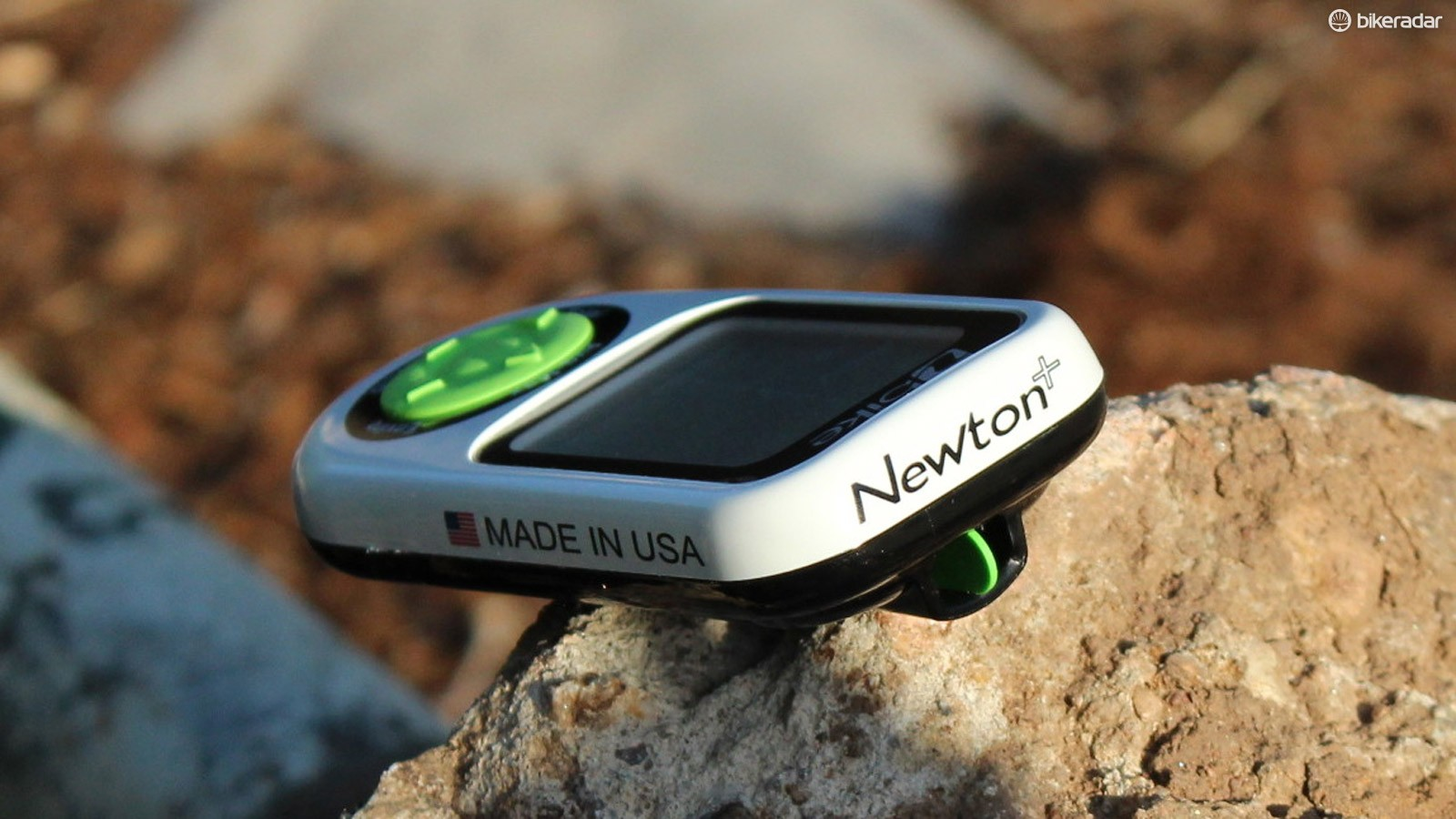 iBike's Newton power meter uses a fair number of calculations to measure the forces opposing a rider - including the wind, with the green-spliced port at center - to determine watt output