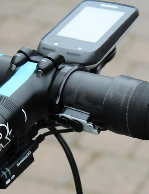 Removing the faceplate of the climber switch keeps the functionality at a fraction of the size. Also note the blacked-out K-Edge Garmin mount