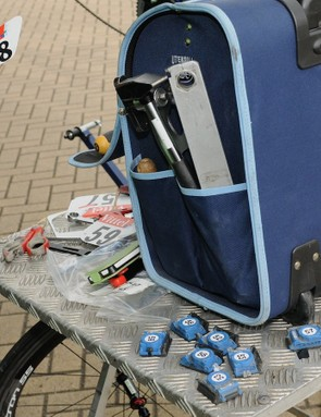 A Cannondale Pro Cycling mechanic preparing the rider's frame numbers and timing chips for fitting