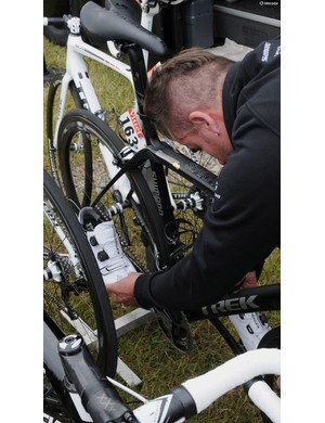 A Trek Factory Racing mechanic checks cleat alignment on Fabian Cancellara's shoes
