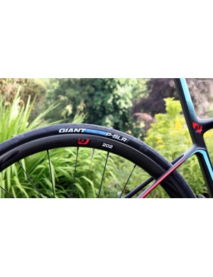 The stock Zipp 202 Disc carbon clincher wheels on the flagship Giant Defy Advanced SL 0 are wrapped with Giant's own 25mm-wide P-SLR1 rubber