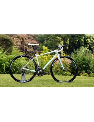The Liv Avail Advanced 1 features a carbon frame built up with a Shimano Ultegra mechanical group, TRP Spyre cable actuated disc brakes, and Giant P-R2 Disc aluminium clincher wheels