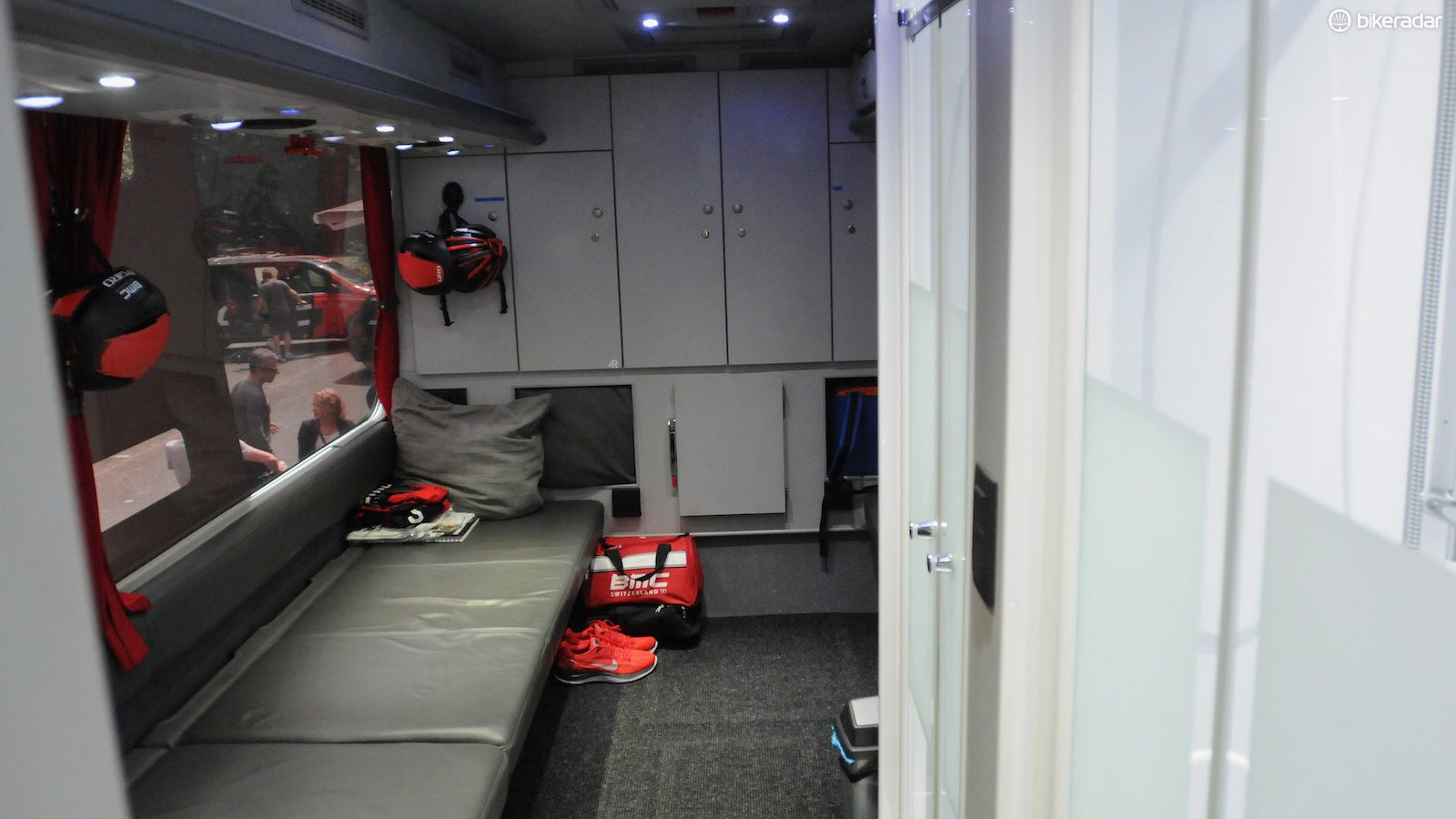 The rear lounge area of the bus has a pair of showers on the right, and room for three riders to change at once. It's also used for pre-race massage and meetings.