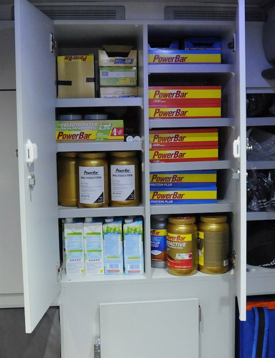 The many cupboards at the rear of the bus contain lots of race nutrition, team caps, medical supplies for injury treatment, and riders' spare kit
