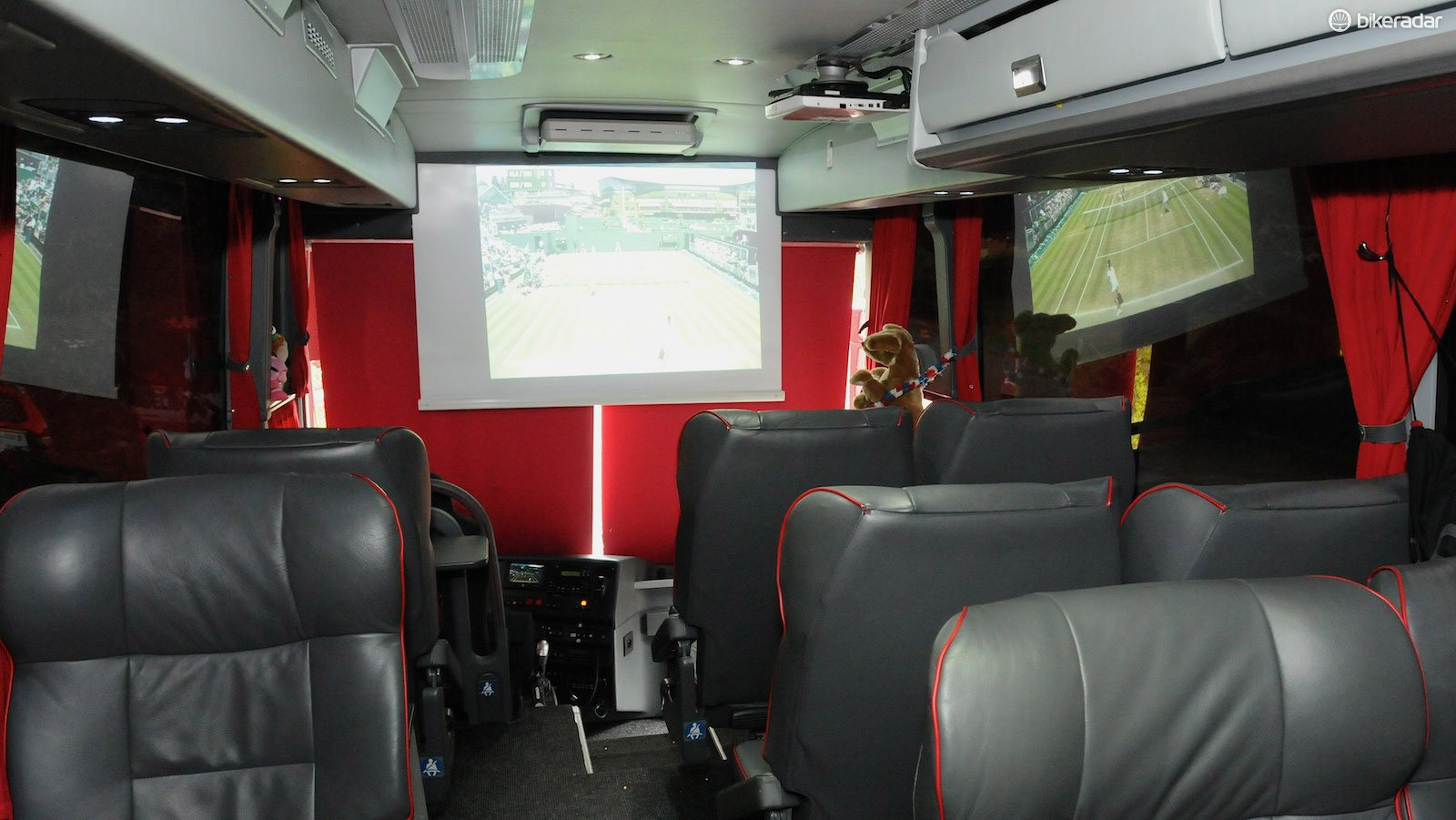 When stationary, a projector and screen can be used to show almost any TV shows or films - or the tennis from Wimbledon