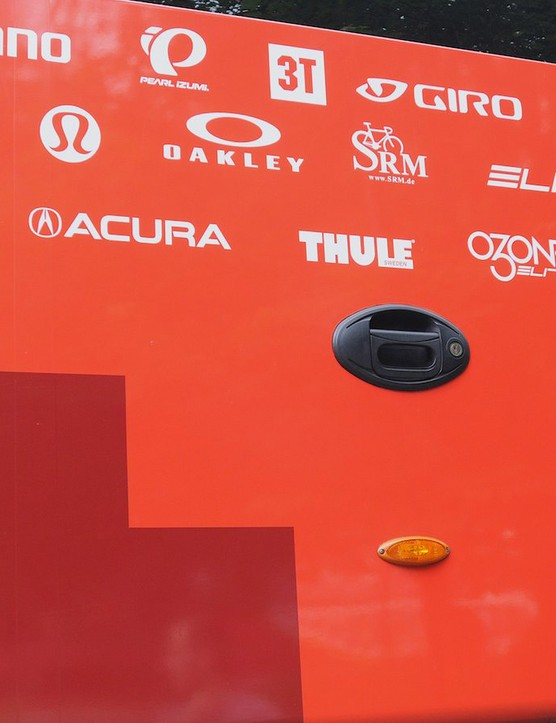 The BMC Racing team's array of sponsors are displayed on the door