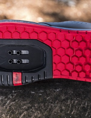 The clipless soles use two different rubber compounds and tread patterns. The black area is a firmer compound with a much shallower tread. This has been dubbed the 'landing strip' and is designed to make clipping back in far easier