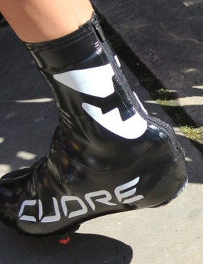 Sometimes shoe covers are worn for aero benefits, sometimes for rain protection, and sometimes to cover up shoes that are not sponsor-correct