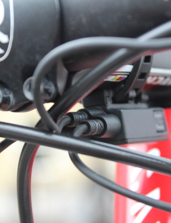 Shimano Di2 has junction boxes that can plug in various satellite shifters. Alternatively, as Paolini's mechanics have done, you can plug the satellite into the rear of the shifter bodies