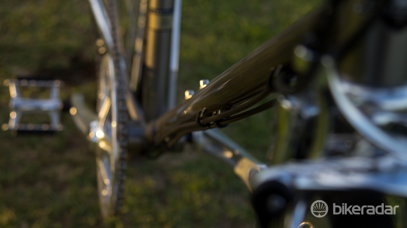 We love the bike's aesthetic… except for those cable guides. Staggering them doesn't look nice