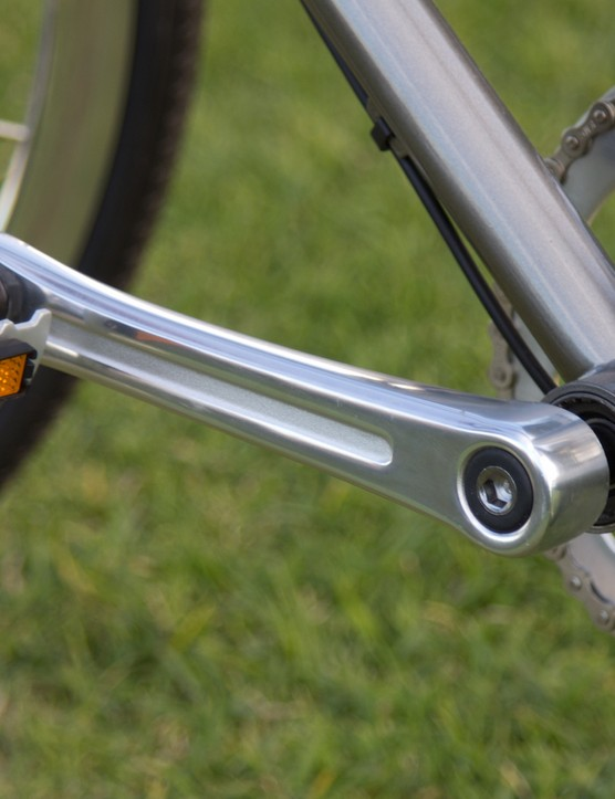 The basic metal pedals work and complement the look well