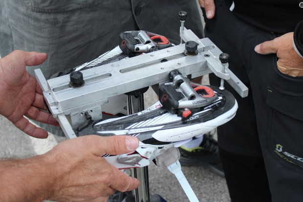 Orica-GreenEdge mechanics have a custom tool for replicating cleat position on multiple pairs of shoes for a rider