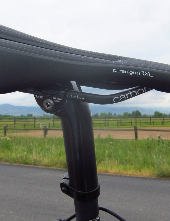 The comfy and supportive Bontrager Paradigm RXL saddle is mounted to Trek's carbon fibre no-cut seatmast head