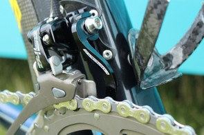 Now derailleur hanger-mounted chain catchers are common. Here is one from Campagnolo on an Astana bike