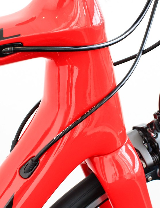 The head tube takes cues from both the Madone and the Domane