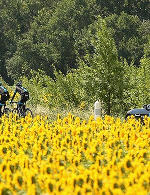 A classic Tour scene with the Team Sky F-Type in pursuit