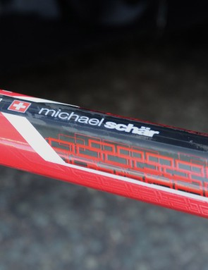 A collection of Swiss flags aboard the frame of BMC's team giant, the 198cm Michael Schar