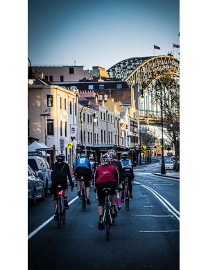 Sydney's Harbour Bridge looms above one of the Rapha Women's 100 rides