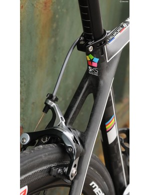 The seat stays cross the seat tube before joining the top tube, enlarging the junction for strength