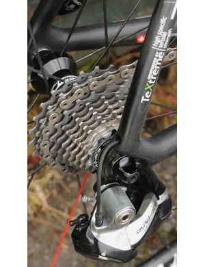 The rear derailleur's Di2 cable exits neatly above the dropout, but has no grommet sealing the hole