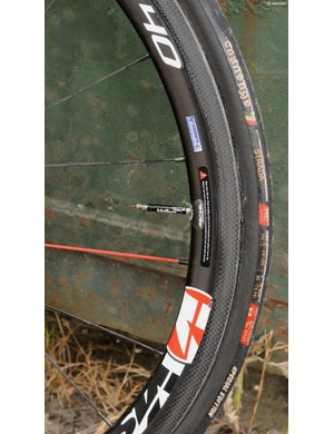 FSA Vision's Metron 40 wheelset is shod with some worn looking Challenge Strada tubulars that were most likely exchanged before race day