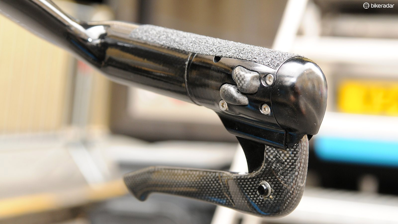Team Sky's Pinarello Bolide comes with these specific electronic shifters and brake levers built in to the bars, leaving the team mechanics to strip the standard Di2 components of their workings and reattach to the bike - not a job for your average home mechanic!