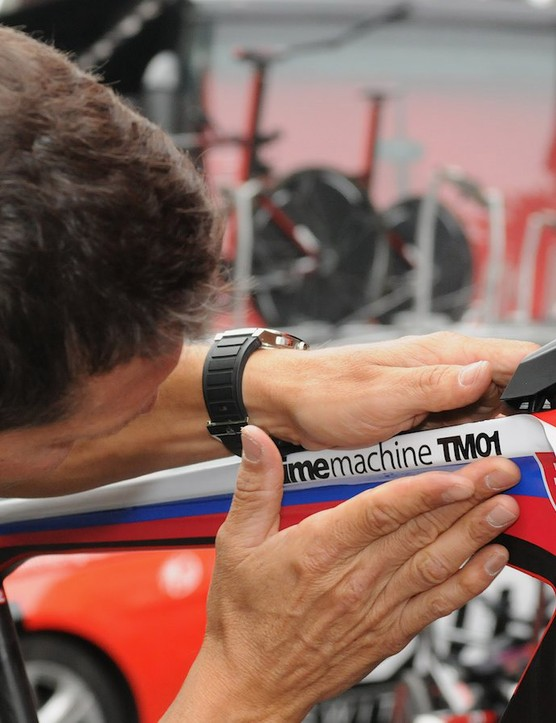 Preparing BMC's TM01 machines and keeping their top tube flags theme going for the time trial