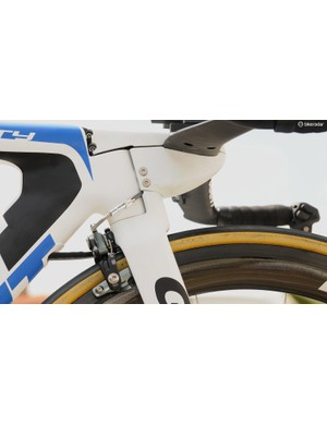 The front brake noodle on the Trinity takes a slightly awkward route, and the wrapped-up Di2 cables sit extremely close to the front tyre
