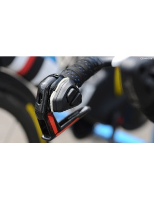 The team use Shimano Di2, but on the P5 time trial bikes, they run Magura's RT8TT hydraulic rim brakes which don't incorporate electric shifters. So the team mechanics stick the shifting buttons from Shimano's TT brake/shift levers to the inside of the Magura brake levers