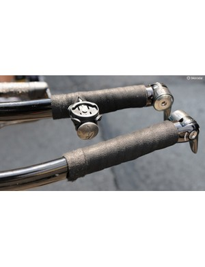 Anything Katusha's mechanics can do… Fine use of a Specialized bar end plug too, even if it is inverted