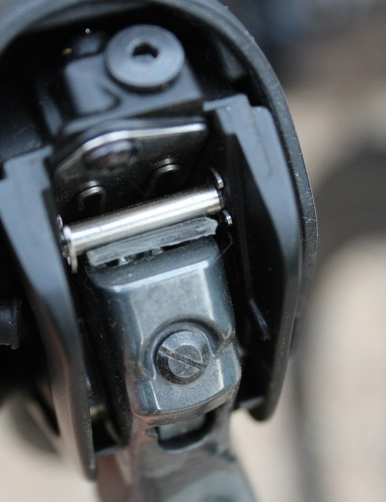 Hydraulic brake levers rattle. James Huang showed me this fix, putting a slice of clear, padded tape on the silver cylindrical bumper above the lever head
