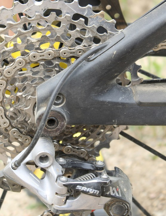 The rear derailleur cables exits at the back of the seat stay