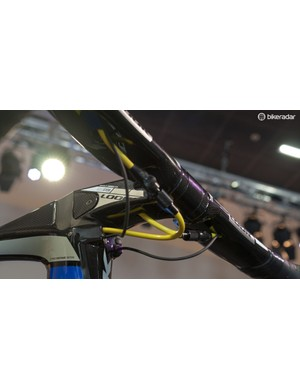 Gear and brake cabling exit under the bars and then enter the frame at the earliest opportunity